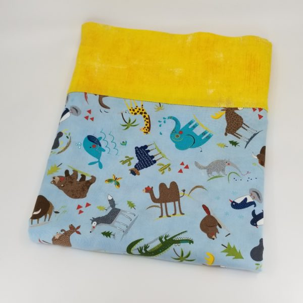Pillowcase with animals around the world on a light blue background with border of yellow