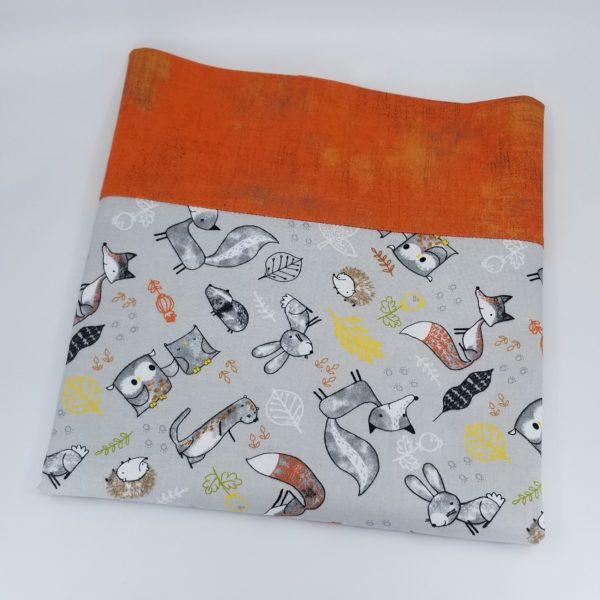 Handmade 100% cotton pillowcase with pattern of forest animals and orange border