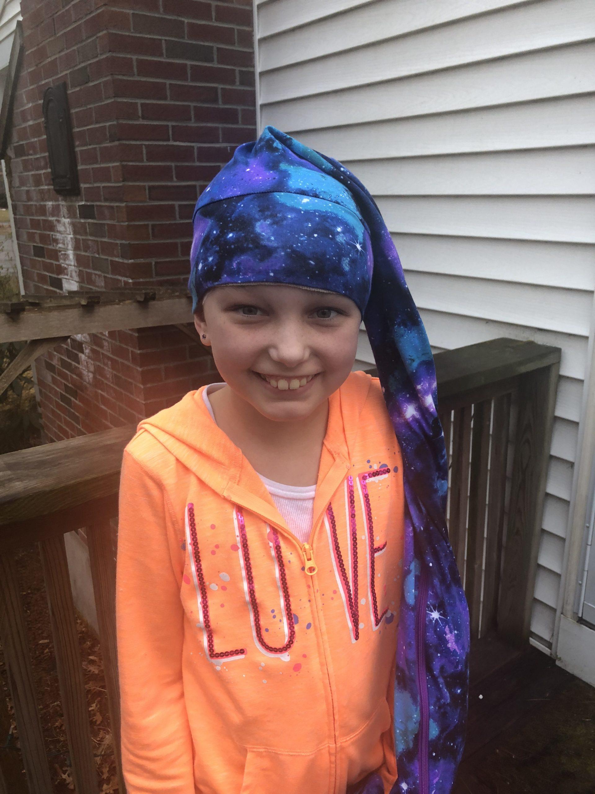 Child wearing a NillyNoggin EEG Cap during an ambulatory EEG test