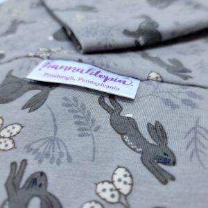Grey Bunnies Hopping on a Grey NillyNoggin EEG Cap close up of material