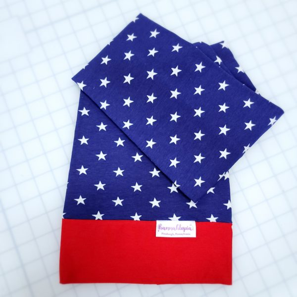 Red and Blue NillyNoggin EEG Cap with White Stars showing folded