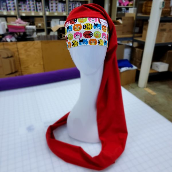 Red and Circle Shapes of Pigs, Cats, Cows, Bumble Bees and Lady Bugs NillyNoggin EEG Cap showing full length on a mannequin head