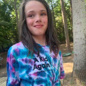 help warrior myla girl wearing blue and purple tie dye tshirt